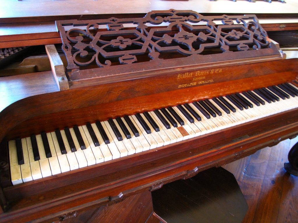 The keys of an 1850s Square Piano built in Boston. They let me play it!