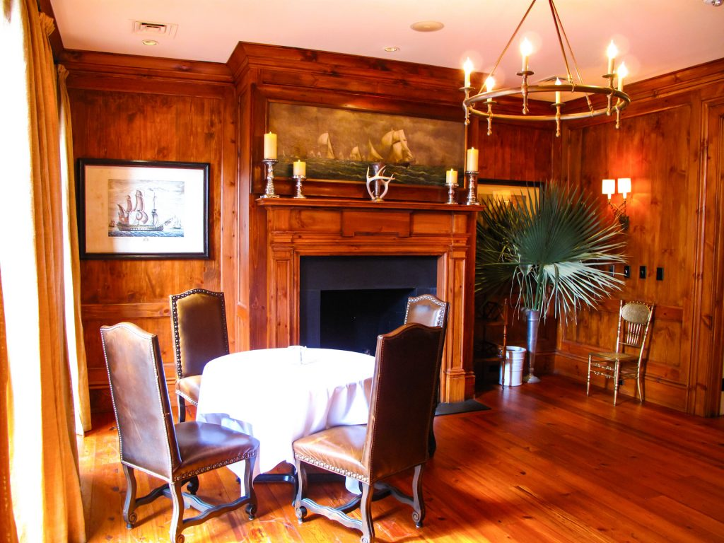 Large wooden room with fireplace.