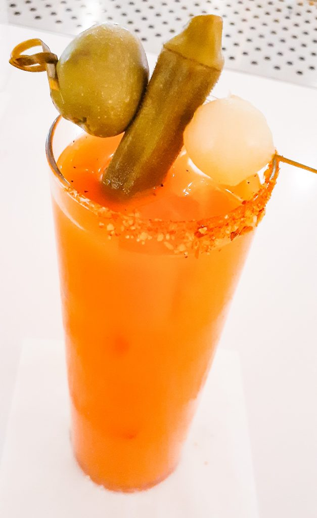 A light-orange, carrot-ginger bloody Mary drink.